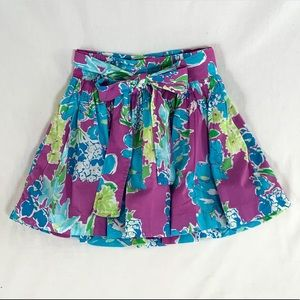 Purple/blue floral skirt with bow belt